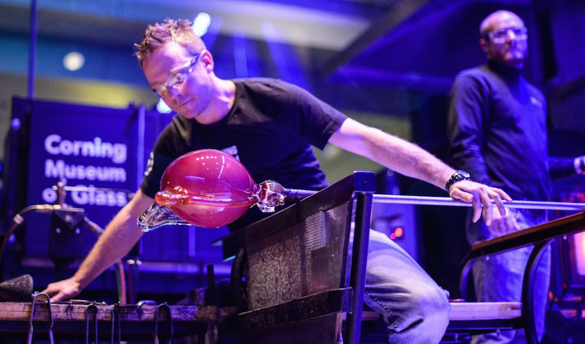A gaffer creates at the Corning Museum of Glass