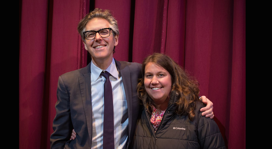 Ira Glass welcomes a guest to an event at the State Theater