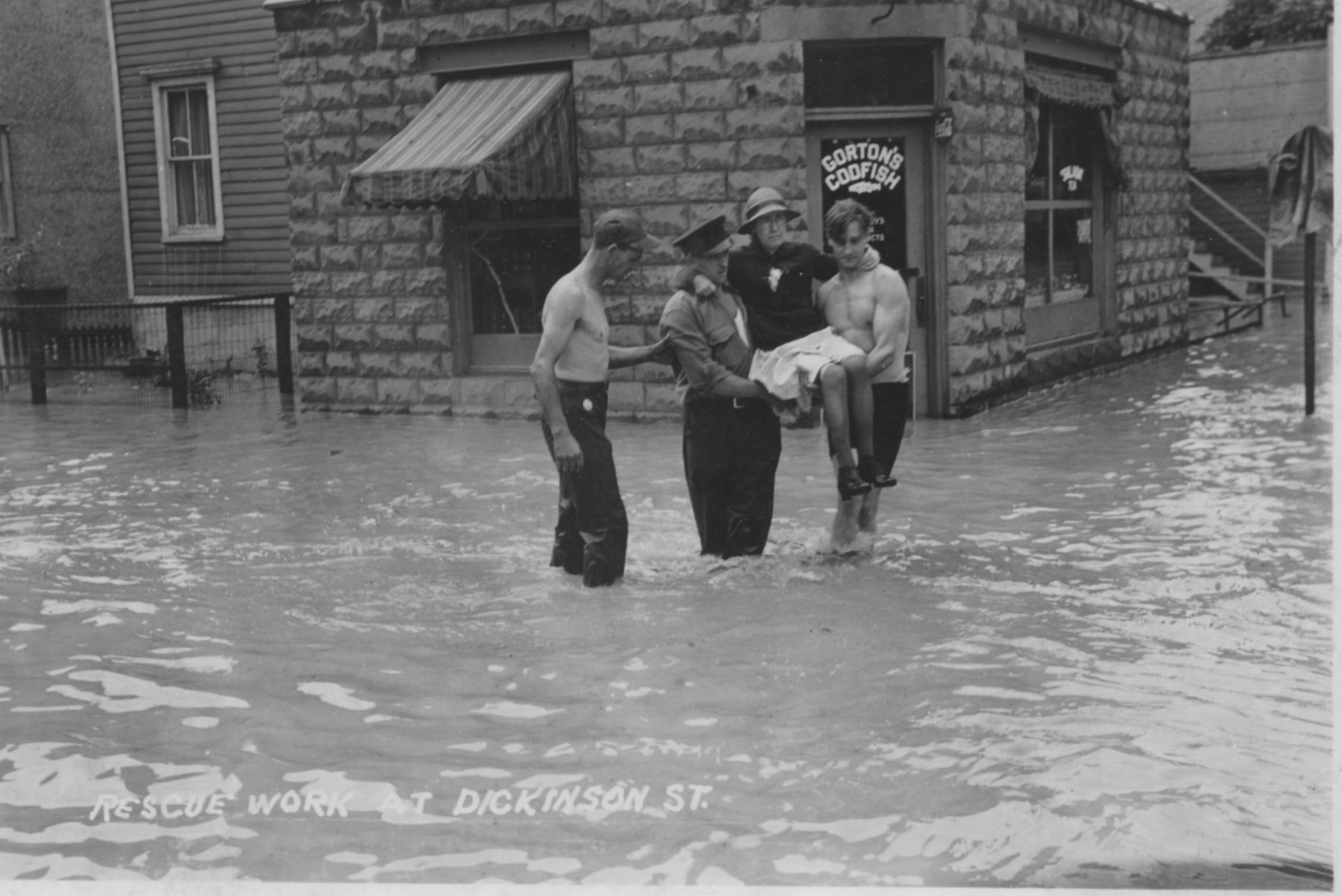 Woman carried through flood waters