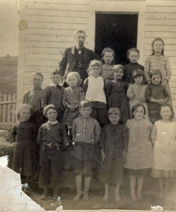 A group of students outside a one room school house in Steuben County