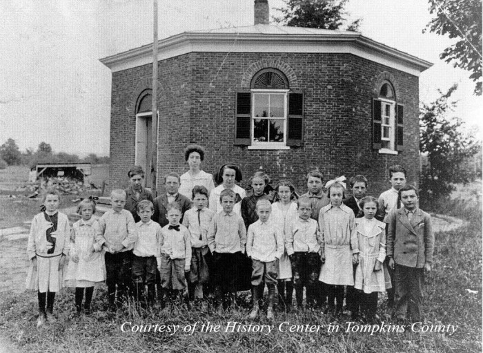 Teacher and Students in front of the one room school house in Dryden, NY.