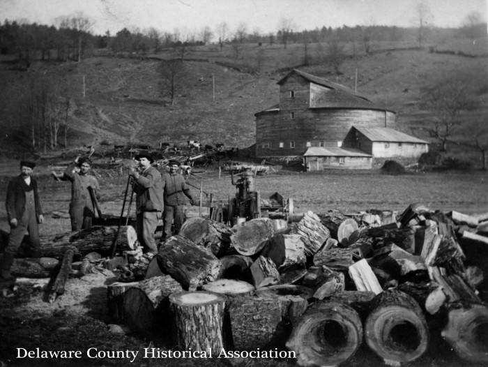 Men on farm cutting wood