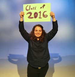 teen girl holding class of 2016 sign