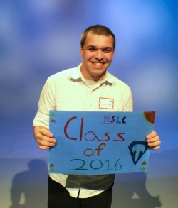 teen boy holding class of 2016 sign