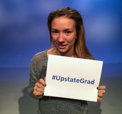 teen girl holding upstate grad sign