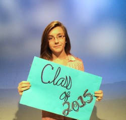 girl holding class of 2015 sign