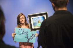 teen girl holding class of 2015 sign