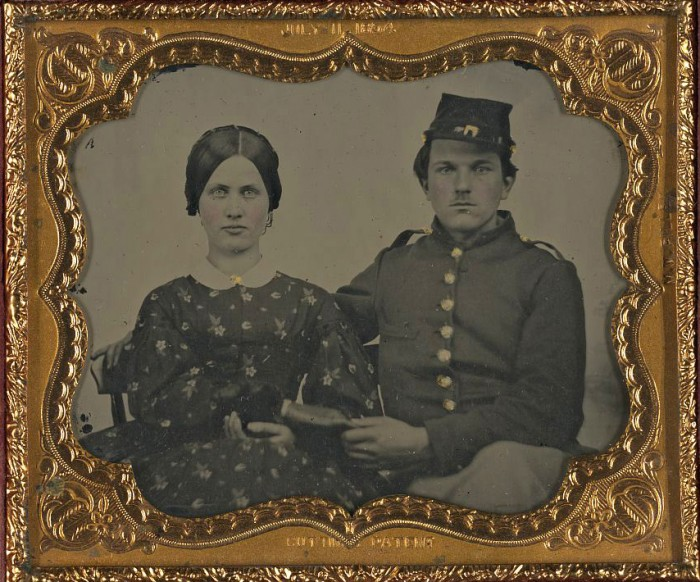 Unidentified soldier in Union uniform with unidentified woman in dress.