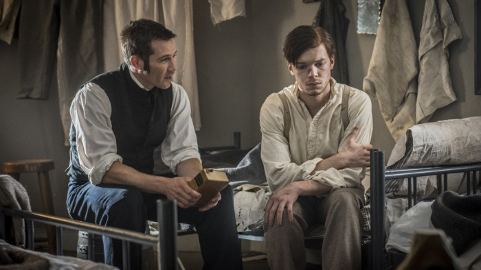 Chaplain Hopkins (Luke MacFarlane) and Tom Fairfax (Cameron Monaghan)Courtesy of Antony Platt/PBS