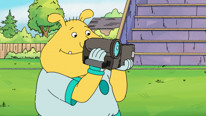 Binky character holding video camcorder
