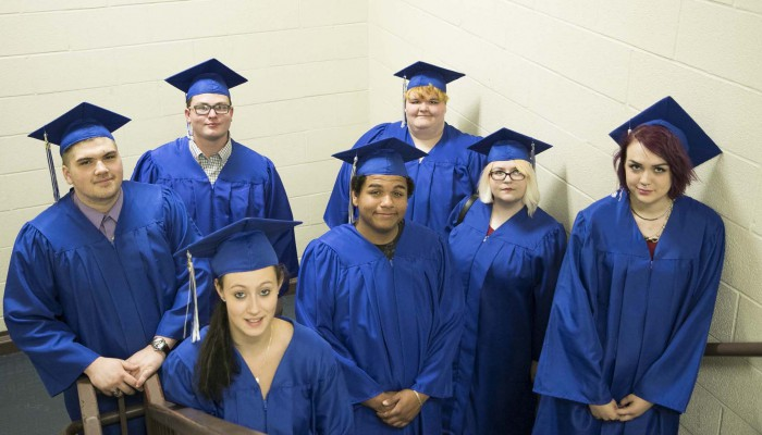 group of high school graduates in cap and gown