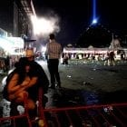 People take cover at the Route 91 Harvest festival after a gunman opened fire on the festival from a room in the Mandalay Bay Resort and Casino in Las Vegas.