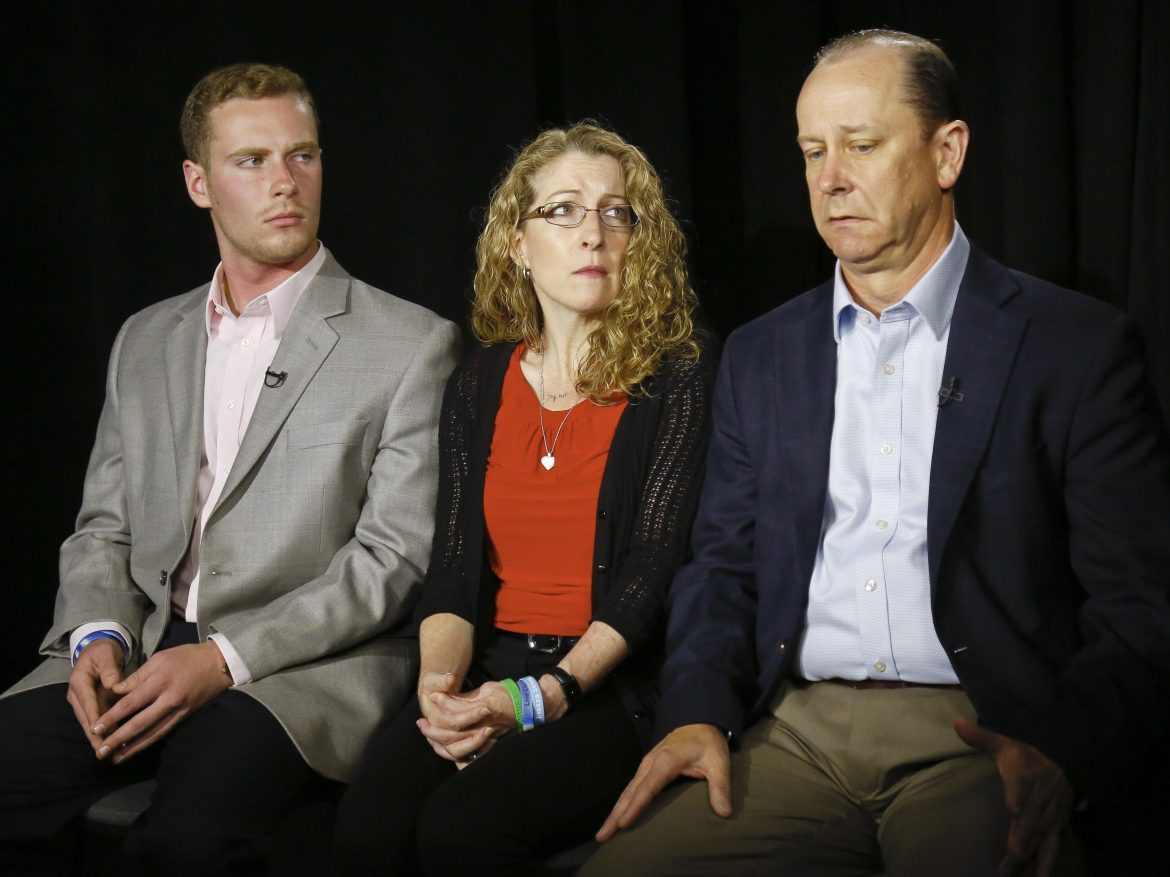 James Piazza, right, seated with his wife Evelyn and son Michael speaks during an interview last year about his son Timothy, who was a sophomore at Penn State when he died after a hazing ritual.