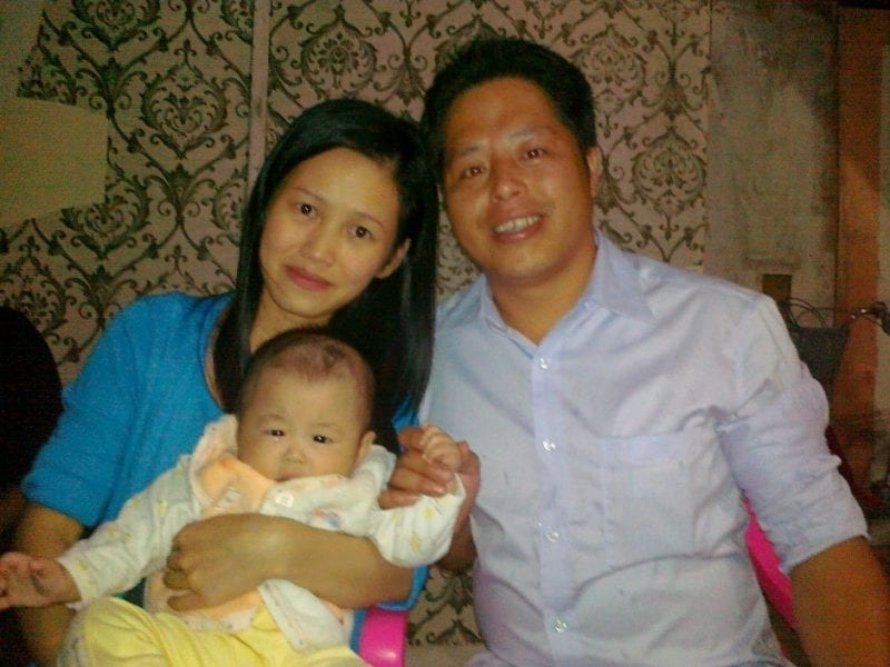 Zhuang Liehong with his wife, Little Yan, and one of his sons, Kaizhi, in 2013 – a year before immigrated to the United States.