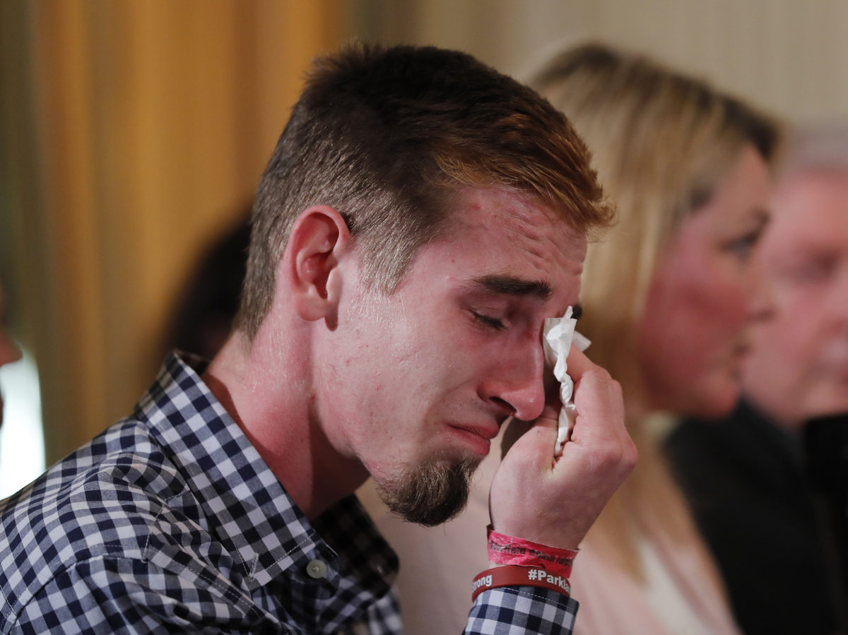 Zeif, sitting next to Nicole Hockley of Sandy Hook Promise, wipes away tears as President Trump hosts a listening session.