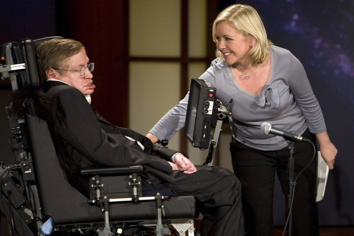 """Lucy Hawkings touches her father as they give a lecture entitled """"Why We Should Go Into Space"""" during the 2008 """"50 Years of NASA"""" lecture series at George Washington University in Washington, D.C."""