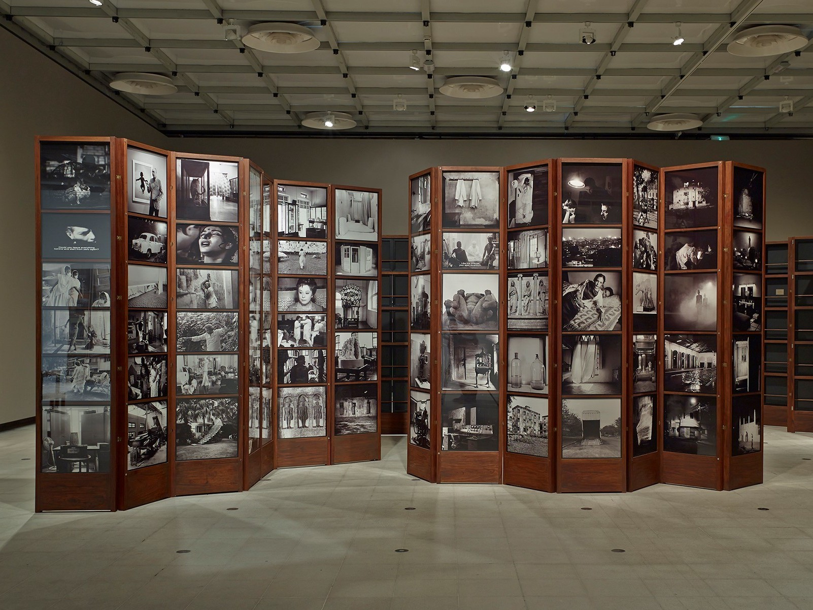Singh's Museum of Chance consists of photographs inside a series of large cabinet-like structures. (Shown here on display at London's Hayward Gallery.)