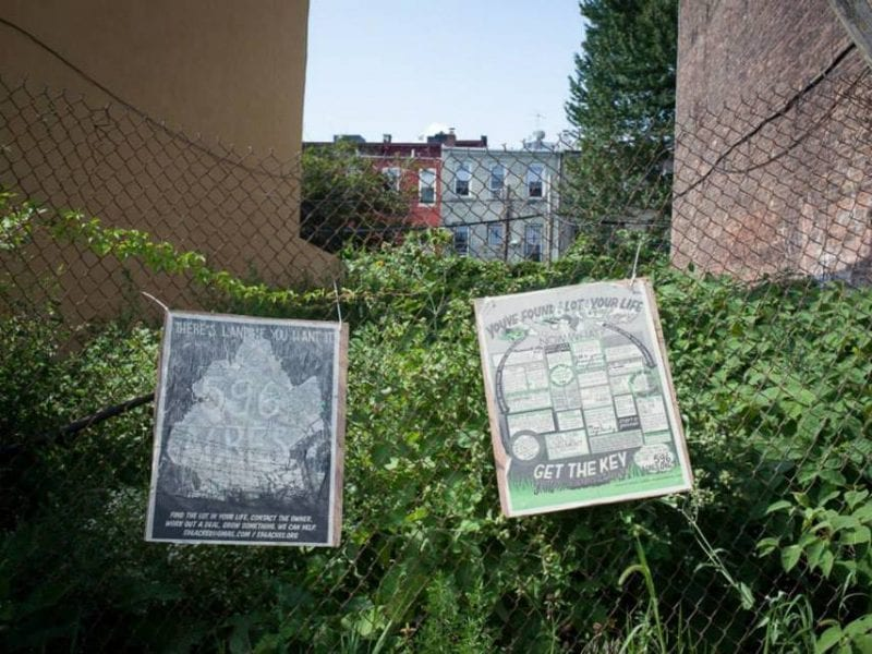 Signs hung up in front of a vacant lot in Weeksville, Brooklyn, in 2014 by members of 596 Acres, an organization that maps vacant lots in New York City and advocates for community stewardship of th at land.