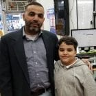 Yemeni-American Fathi Alhuthaifi stands with his son Ahmed, 9. His wife has been denied a visa under the Trump administration's travel ban.