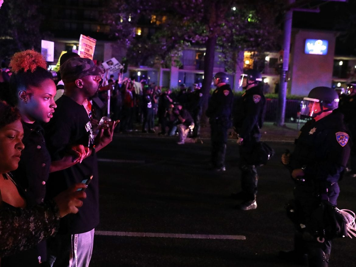 Sheriff's SUV hits protester during vigil for man killed by police