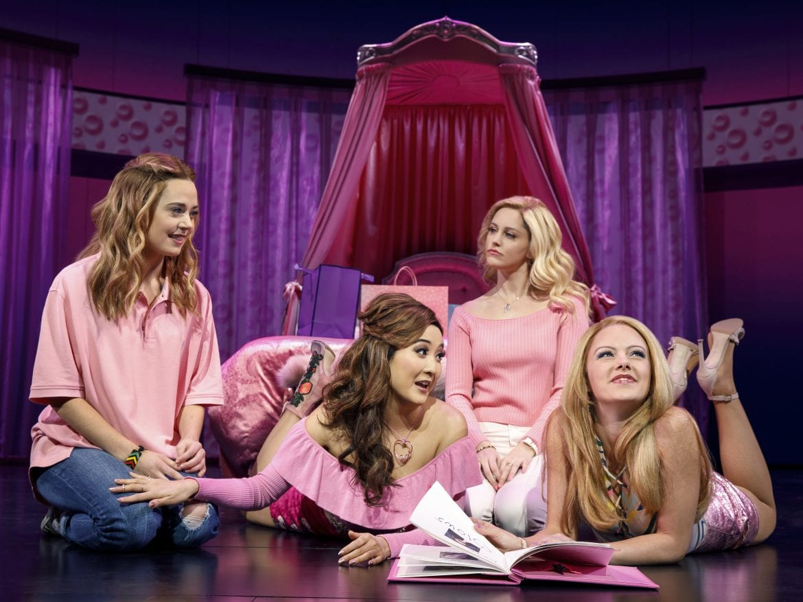 Cady (Erika Henningsen, left) wears pink along with fellow Plastics Gretchen (Ashley Park), Regina (Taylor Louderman) and Karen (Kate Rockwell) in the musical Mean Girls.