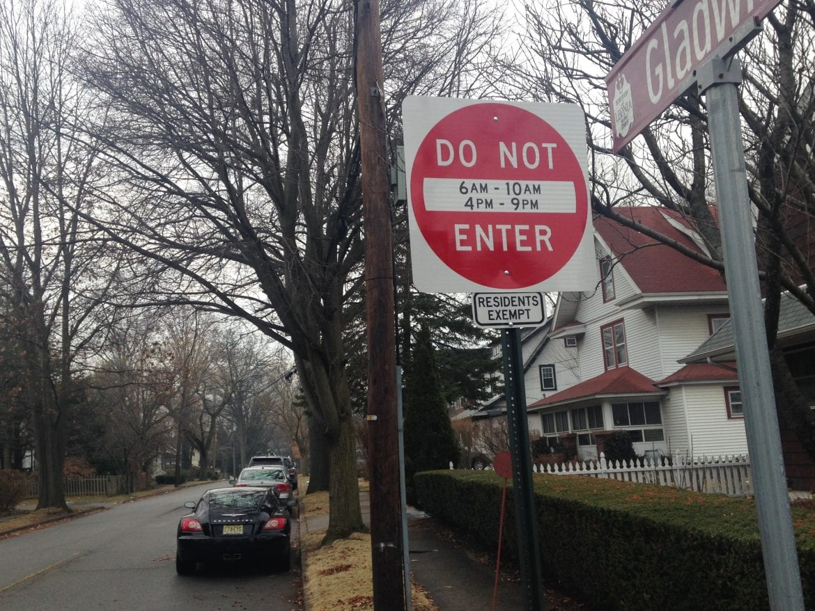A street sign tells out-of-towners to keep off a side street in Leonia, N.J., where officials are trying to redirect commuters on their way to the nearby George Washington Bridge into New York.