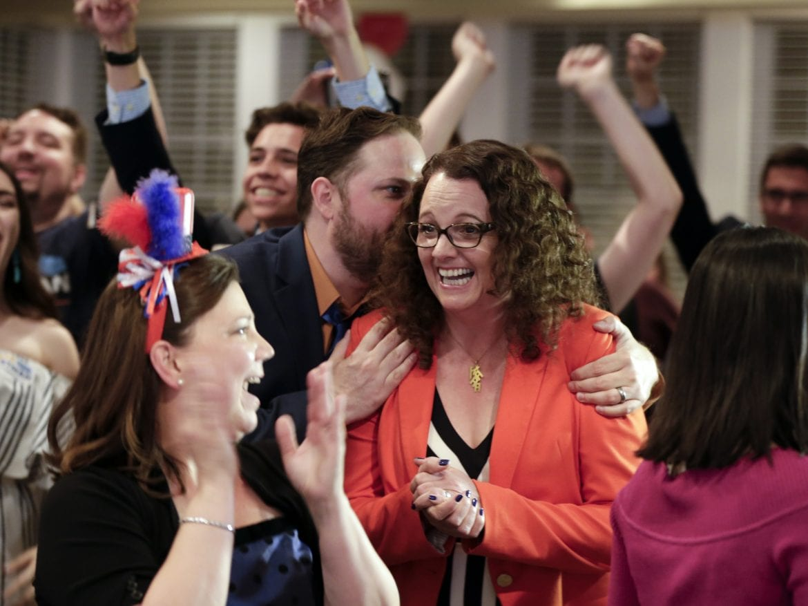 Kara Eastman, winner of the Nebraska 2nd Congressional District primary Tuesday, is hugged by her campaign manager, Ben Onkka, in Omaha, Neb.