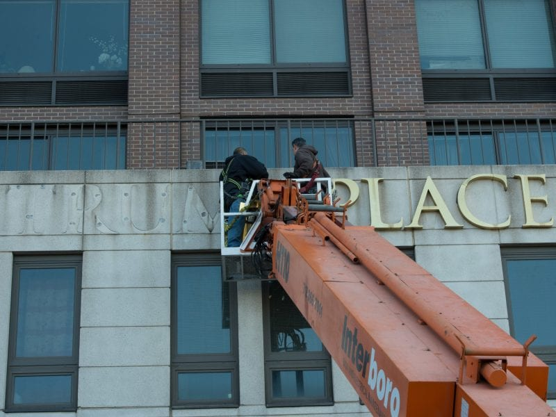 Workers remove Trump signage from Trump Place on Riverside Boulevard. on Manhattan's West Side on Nov. 16, 2016. A separate building nearby has asked for permission to remove Trump's name.