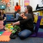 Kelly Zimmerman holds her son Jaxton Wright at a parenting session at the Children's Health Center in Reading, Pa. The free program provides resources and social support to new parents in recovery from addiction, or who are otherwise vulnerable.