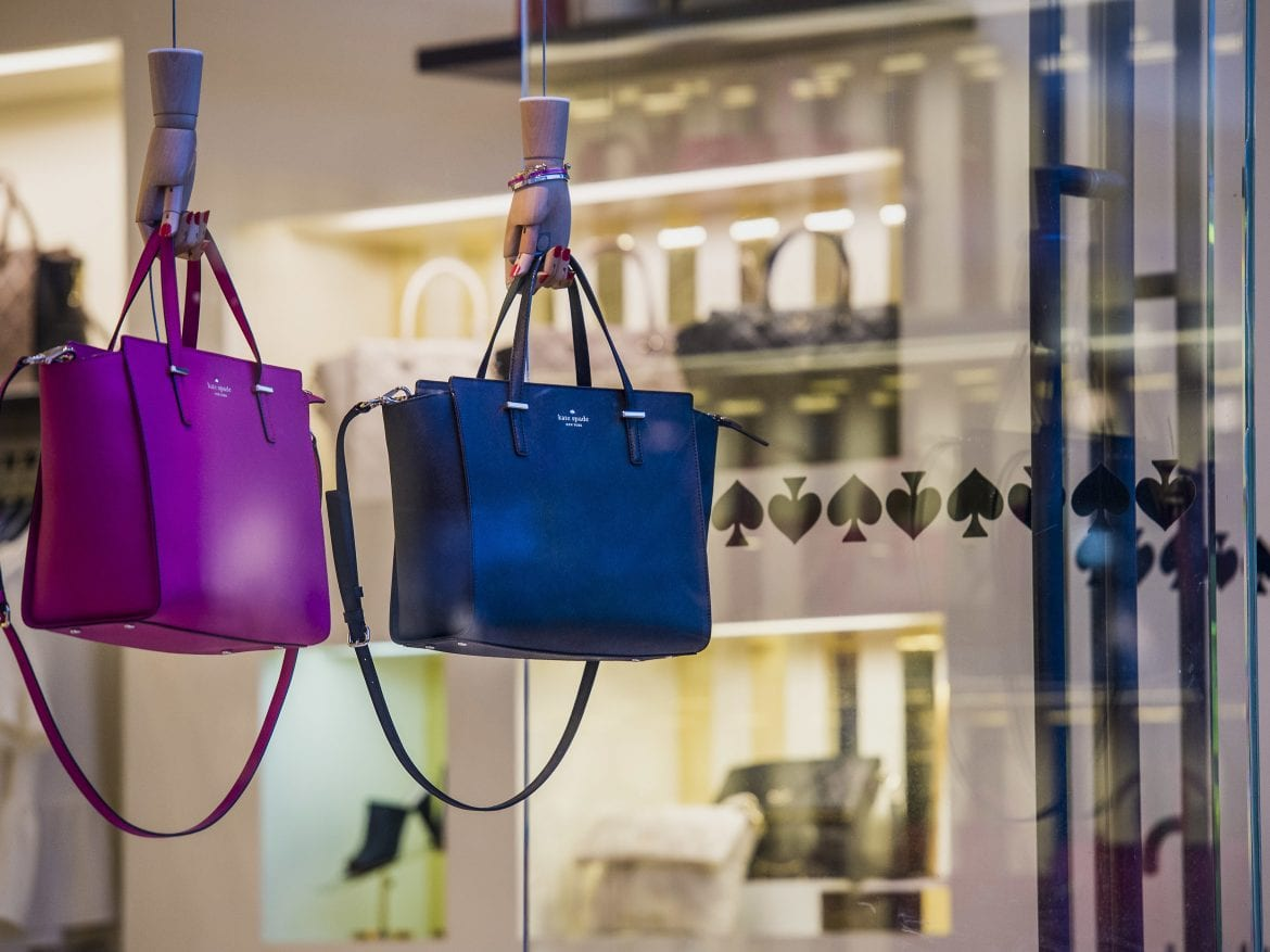 "Handbags — which are not examples of the ""Sam"" mentioned below — hang on display in the window of a Kate Spade & Co. store in Corte Madera, California, U.S., on Friday, Feb. 27, 2015."