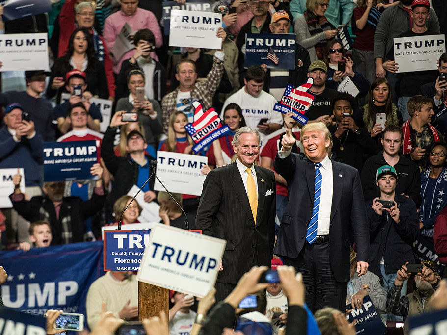 Then-Republican presidential candidate Donald Trump is introduced by then-South Carolina Lieutenant Governor Henry McMaster at a campaign rally in Florence, S.C., in February 2016. Now Trump is president and McMaster is governor and campaigning for a full term.
