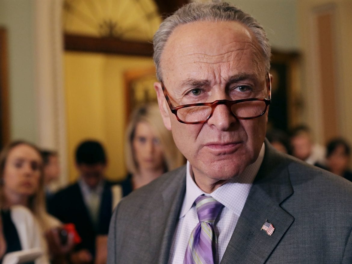 Senate Minority Leader Charles Schumer, D-N.Y., talks to reporters following the weekly Senate Democratic policy luncheon at the U.S. Capitol May 22, 2018.