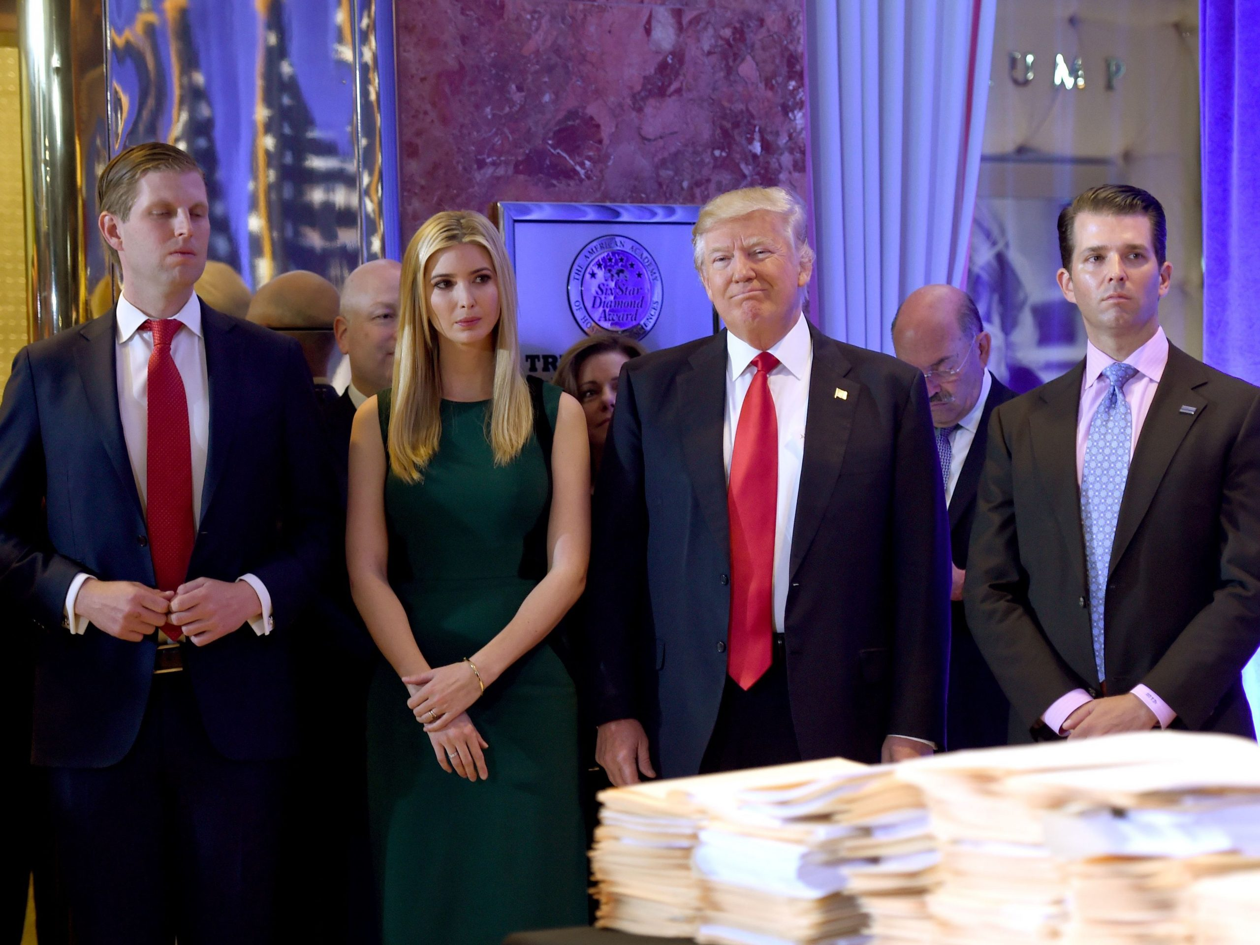 """President Trump, pictured with his children Eric, Ivanka and Donald Jr. in January 2017, said Thursday on Twitter that """"I won't settle this case!"""""""