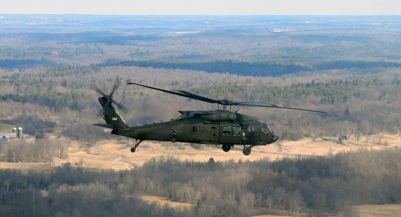 Local officials, members of the media and invited guests flew in a helicopter to a Ft. Drum range to get a better perspective on the 10th Combat Aviation Brigade's training exercise.