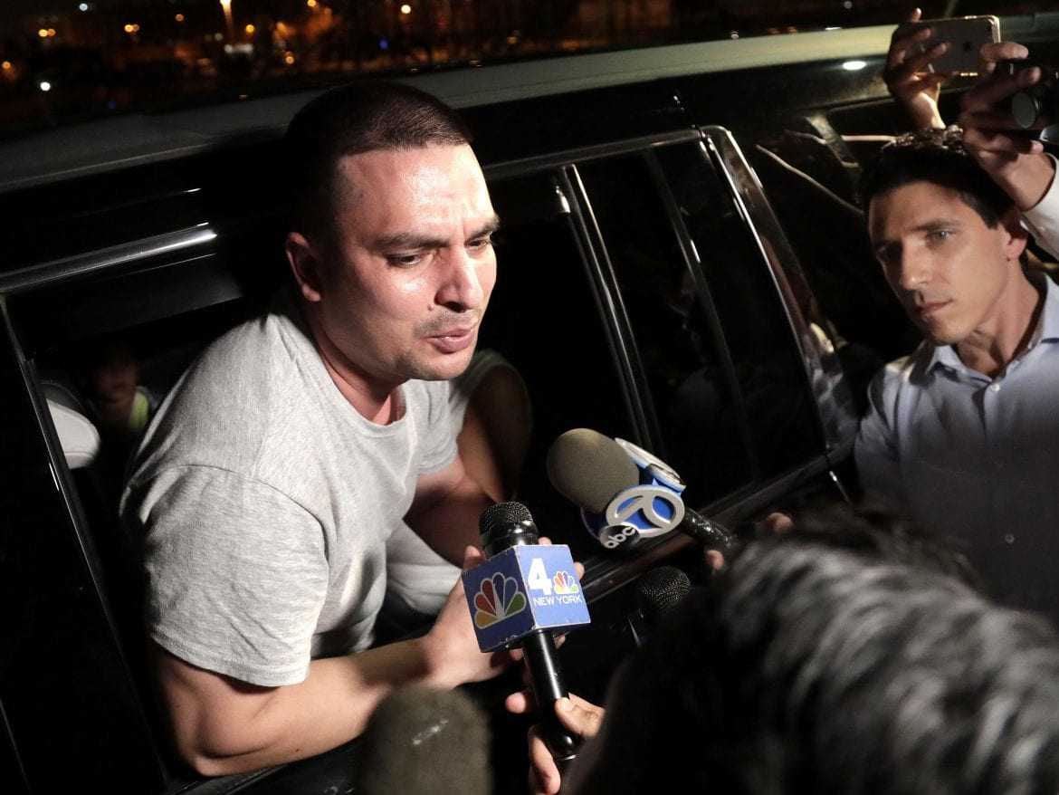 Pablo Villavicencio leans out of an SUV while talking to reporters after being released from the Hudson County Correctional Facility, on Tuesday.
