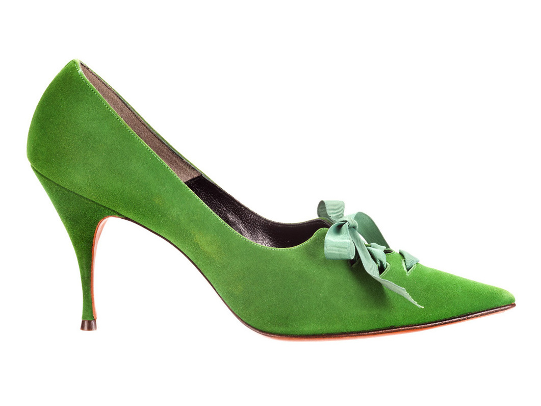 These pointed-toe laced pumps, circa 1964, are made of green suede and grosgrain ribbon.