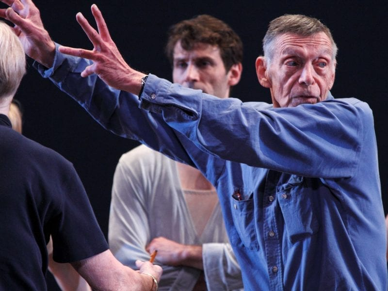 Paul Taylor, seen here directing the dance company that bears his name, left his major mark on the dance world as a choreographer.