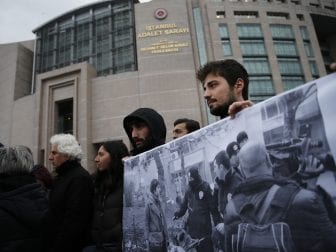 Demonstrators hold a banner outside a court in Istanbul, last December, when Turkish academics went on trial for signing a declaration calling for the end of hostilities in Turkey's southeast.