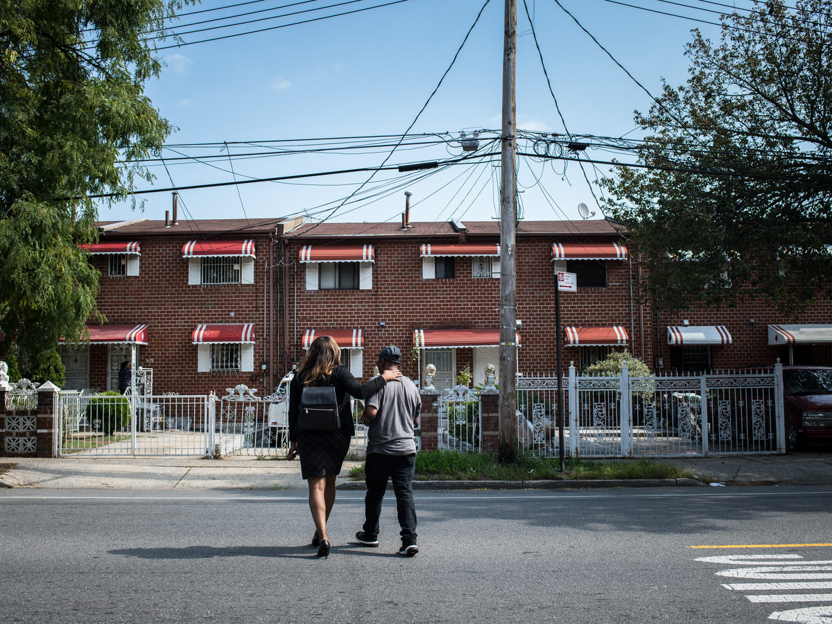Audra Palacio walks with her father Peter Palacio back to their house. The house is part of an affordable housing plan called Nehemiah. The Palacios moved here in 1983, when Audra was six years old.