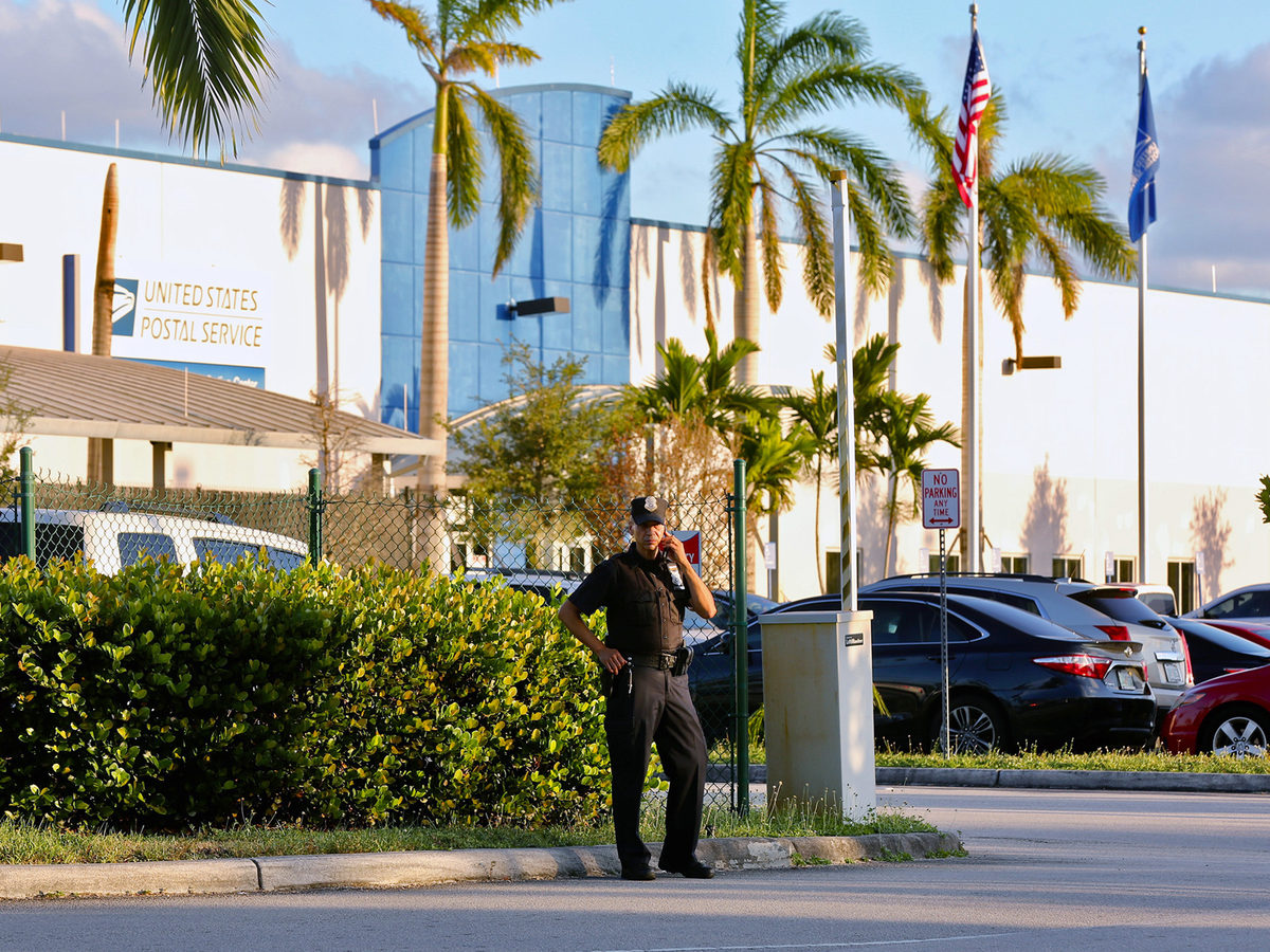 Police outside the U.S. Post Office Royal Palm Processing & Distribution Center, in Opa-locka, Fla. on Thursday.