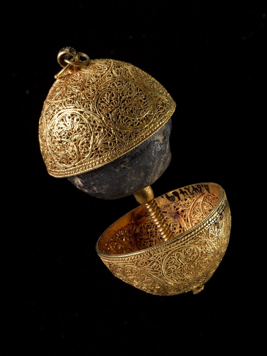 """A bezoar, encased in a gold filigree shell, is a """"stone"""" of indigestible mass formed in the guts of animals. They were once believed to be antidotes to poison — and play that role in the Harry Potter universe."""