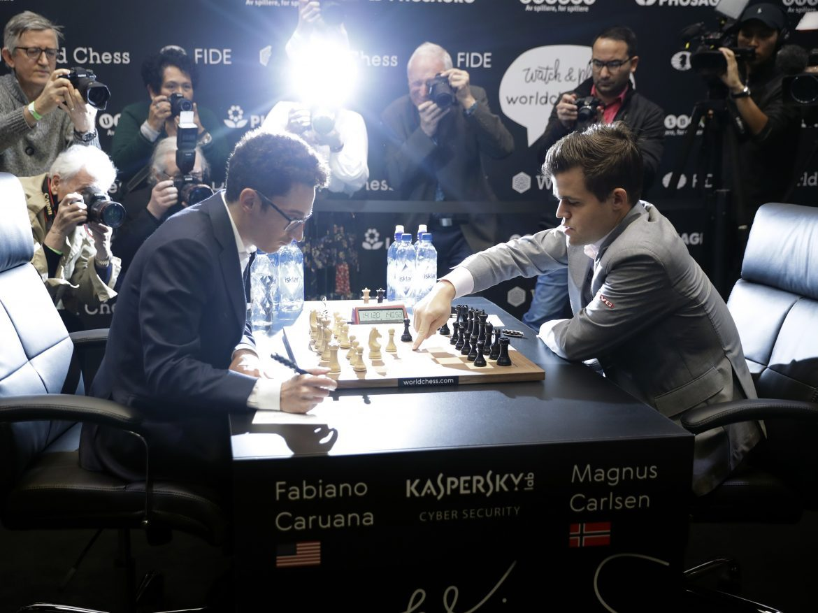 Reigning chess world champion Magnus Carlsen (right), from Norway, plays Italian-American challenger Fabiano Caruana in the first few minutes of round 12 of their World Chess Championship match on Monday in London.