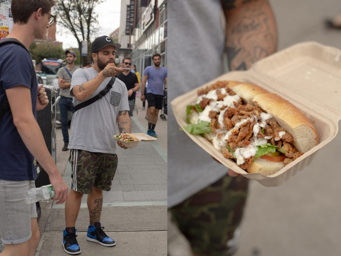 Erick Castro photographs his vegan fried-oyster-mushroom po'boy outside of a Whole Foods in Brooklyn.