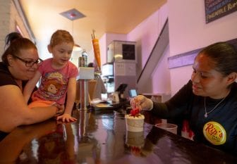 Rip's employee Rachely Hernandez makes a vegan chocolate and marshmallow sundae for frequent customer Marianne Stephan, and her niece, Maddie. The ice cream is made from coconut cream and cashews.