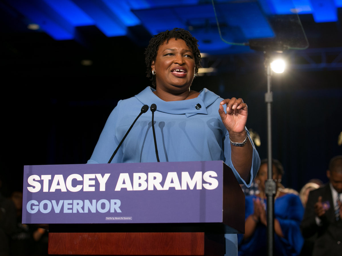 Democratic gubernatorial candidate Stacey Abrams addresses supporters at an election watch party on Tuesday. Abrams has yet to concede to her Republican opponent, Brian Kemp, contending there are thousands of absentee and provisional ballots yet to be counted.