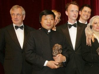 Lu Guang holding his Henri Nannen Award in 2008 in Hamburg, Germany.
