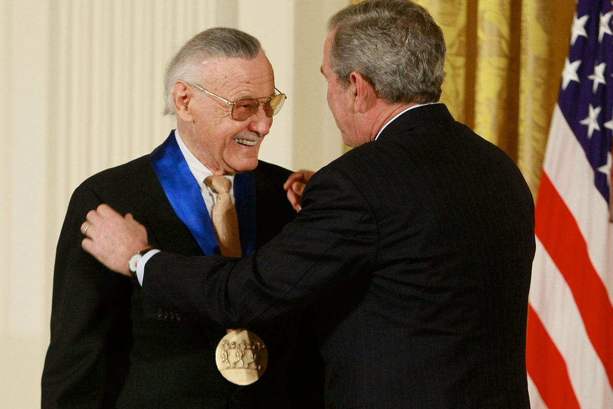 Former President George W. Bush congratulates Lee, founder of POW! Entertainment, after presenting him with the 2008 National Medal of Arts on Nov. 17, 2008, at the White House.