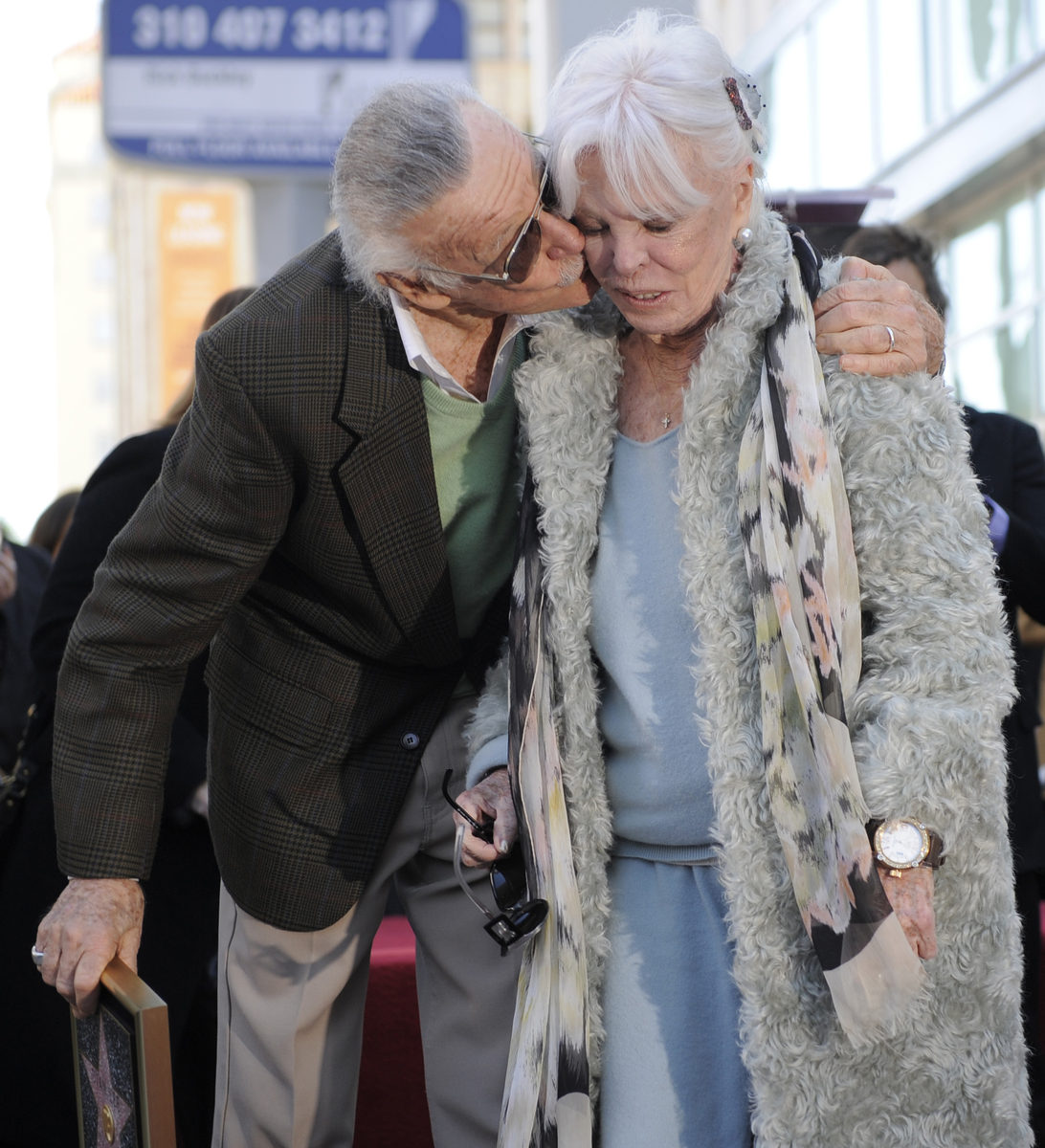 Lee gives his wife, Joan, a kiss after he received a star on the Hollywood Walk of Fame, Jan. 4, 2011. Joan Lee died in 2017.