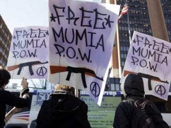 Supporters of convicted police killer Mumia Abu-Jamal rally outside the federal courthouse in 2010. A judge in Philadelphia has reinstated appeal rights to former Black Panther Mumia Abu-Jamal who has long maintained his innocence as his case gained international attention.