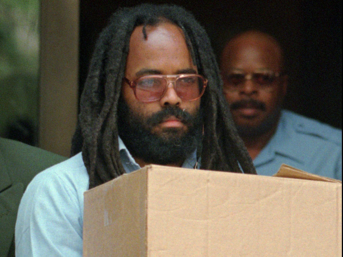 Mumia Abu-Jamal leaves Philadelphia's City Hall after a July 1995 hearing. His conviction of the murder of a police officer has gained national attention.